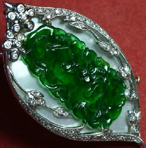 Imperial green jadeite plaque on mother of pearl
